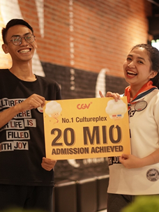 CGV Indonesia employees are posing for a photo in celebration of surpassing 20 million visitors.