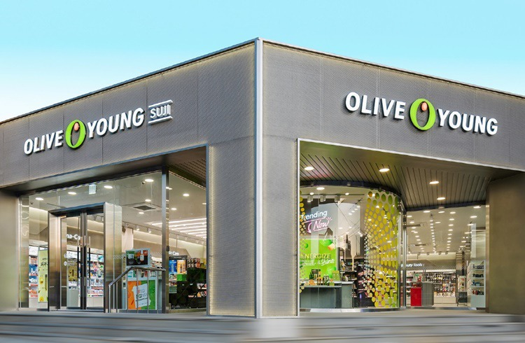 Exterior of an Olive Young store featuring the new brand identity I logo (store name: Olive Young Suji Store)