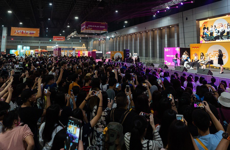 K-Pop group ITZY onstage for 'KCON GIRLS' featuring K-Beauty and female lifestyle programs and fans in excitement